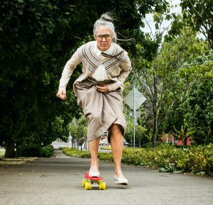 Determined Grandma on Skateboard